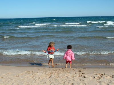 Lila and Eva testing out the waters of Lake Superior at Bete Gris in Keewenaw County, MI.
