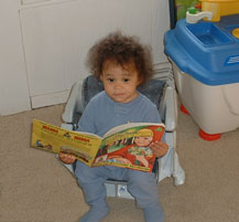 "Eva ""reading"" a book."