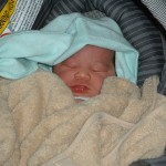 Newborn Eva in a carseat