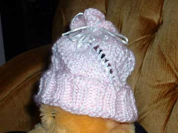 Knitted baby hat on bumblebee