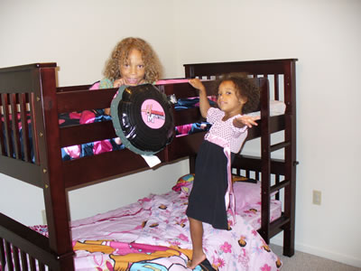 Lila and Eva posing in their new bunk bed!