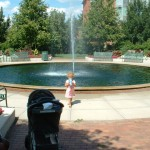 Lila at the fountain outside the Student Services Building at Michigan State University