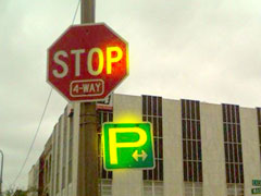 """P"" for Parking sign in Owosso, MI. The P is pulled out of proportion."