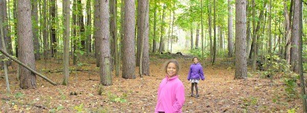 Lila and Eva pausing for a photo on the way into Ringwood Forest, near St Charles, MI.