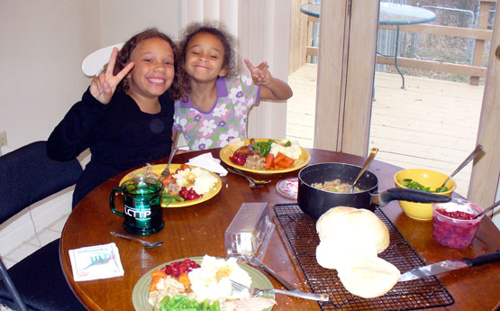 Lila and Eva wishing you peace on Thanksgiving, 2009.
