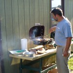 Bob grilling some burgers outside the huts at Camp Perry.