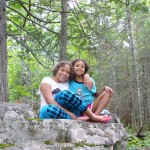 Lila and Eva posing on a boulder.