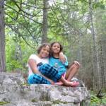 Lila and Eva posing on a boulder.