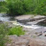 River, rocks, trees.