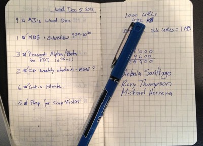 Photo of my notebook showing a prioritized daily list.