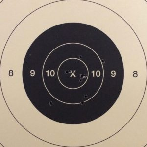 A pistol target scoring a 99 out of 100.